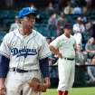 This film image released by Warner Bros. Pictures shows Chadwick Boseman as Jackie Robinson in a scene from