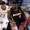 Miami Heat forward LeBron James (6) drives past New Orleans Pelicans forward Anthony Davis (23) during the first half of an NBA basketball game, Saturday, March 22, 2014, in New Orleans. (AP Photo/Jonathan Bachman)