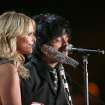 "Miranda Lambert, left, and Billie Joe Armstrong perform ""When Will I be Loved"" on stage at the 56th annual Grammy Awards at Staples Center on Sunday, Jan. 26, 2014, in Los Angeles. (Photo by Matt Sayles/Invision/AP)"