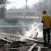 Community Photo By:  Mike Howard  Submitted By:  Mike, OKC A firefighter hoses down the remains of a deck during a fire in SE OKC.