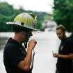 Oklahoma City firefighters communicate with other firefighters  in rescue craft at scene of swift-water rescue west of Sooner Road on Hefner.  Firefighters rescued a stranded citizen but then they had to be saved after their rescue boat sank. Torrential rain caused flooding in Oklahoma City, Monday, June 14, 2010.     by Jim Beckel, The Oklahoman