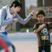 Instructor Melissa Meyers helps Dane Plaks, 8, of Edmond, with his technique during an after school archery class at the at the Edmond Multipurpose Activity Center at Mitch Park in Edmond on Tuesday, Oct. 11, 2010. Photo by John Clanton, The Oklahoman