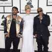 Mack Maine, from left, Paris Hilton and Birdman arrive at the 56th annual Grammy Awards at Staples Center on Sunday, Jan. 26, 2014, in Los Angeles. (Photo by Jordan Strauss/Invision/AP)