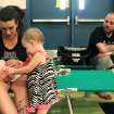 Nicky Morris sits with her children, Gabriel, 5 months, and Arianna, 1, and her husband, Tommy, Thursday, Aug. 2, 2012, at Central Valley High School in Shasta Lake, Calif. The school was set up as a Red Cross shelter for people displaced by a wildfire that threatened about 100 homes and other structures in the Shasta-Trinity National Forest in Northern California. AP photo
