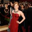 ** LINDA MILLER'S COMMENTARY:  Wear red if you want to get noticed. Love, love, love that necklace. I'm so buying oversize jewelry this spring.  **