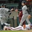 Clemson's Garrett Boulware, front, lies on the ground after being tagged out at third as South Carolina players celebrate at an NCAA college baseball game on Friday, March 1, 2013, in Clemson, S.C. (AP Photo/Anderson Independent-Mail, Mark Crammer)  GREENVILLE NEWS OUT, SENECA NEWS OUT