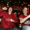 17yr old Conner Davy and 16yr old Tyler Hewett of Washington, watch the University of Oklahoma and the Florida Gators play in the BCS National Championship football game at the Warren Theatre in Moore , Okla. January  08, 2009.  BY STEVE GOOCH, THE  OKLAHOMAN