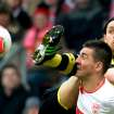 Dortmund's Neven Subotic, behind, and  Stuttgart's Vedad Ibisevic, front, challenge for the ball during the German Bundesliga soccer match between VfB Stuttgart and Borussia Dortmund in Stuttgart, southern Germany, Saturday March 30, 3013. (AP Photo/dpa,Marijan Murat)