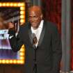 "Kenny Leon accepts the award for best direction in a play for ""A Raisin in the Sun"" at the 68th annual Tony Awards at Radio City Music Hall on Sunday, June 8, 2014, in New York. (Photo by Evan Agostini/Invision/AP)"