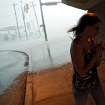 Kristina St. Clair takes shelter from the hail under an overpass at Wilshire and Broadway Extension during a storm in the Oklahoma City metro area on Sunday, May 13, 2010. By John Clanton, The Oklahoman