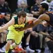 Baylor guard Brady Heslip (5) is pressured by Oklahoma State forward Brian Williams (4), right, in the first half of an NCAA college basketball game, Monday, Feb. 17, 2014, in Waco, Texas. (AP Photo/Waco Tribune Herald, Rod Aydelotte)