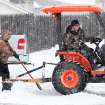 Men use a tractor and shovels to clear snow from the parking lot of this restaurant on Air Depot in Midwest City.  A second winter storm in a week dumped about 6 inches of snow in the Oklahoma City area Tuesday morning, Feb. 9, 2011.   Photo by Jim Beckel, The Oklahoman