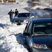 Abandoned cars buried in deep snow drifts on Britton Road between Broadway and Kelley. Many spent Christmas Day, Dec. 25, 2009,  digging out from record snow storm that dumped 14 inches of snow in the Oklahoma City area.   Photo by Jim Beckel, The Oklahoman