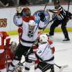Los Angeles Kings left wing Kyle Clifford, center, celebrates his goal on Detroit Red Wings goalie Jimmy Howard (35) during the second period of an NHL hockey game in Detroit, Wednesday, April 24, 2013. (AP Photo/Carlos Osorio)