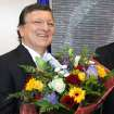 European Commission President Jose Manuel Barroso reacts, as he received flowers by Norway's ambassador to the EU Atle Leikvoll, after the 2012 Nobel Peace Prize was given to the EU, at the European Commission headquarters in Brussels, Friday, Oct. 12, 2012. The European Union won the Nobel Peace Prize on Friday for its efforts to promote peace and democracy in Europe, an award given even though the bloc is struggling with its biggest crisis since it was created in the 1950s.  (AP Photo/Yves Logghe) ORG XMIT: YL107