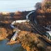 Cars from a Metro-North passenger train are scattered after the train derailed in the Bronx borough of New York, Sunday, Dec. 1, 2013. The Fire Department of New York says there are