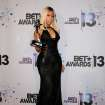 Nicki Minaj poses backstage with her award for best female hip hop artist at the BET Awards at the Nokia Theatre on Sunday, June 30, 2013, in Los Angeles. (Photo by Scott Kirkland/Invision/AP)