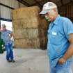 Danny Freerer in his barn near Fargo after unloading a shipment of hay  delivered by trucker Tracy Freeman,  background, on Tuesday, July 26, 2011.  The hay is stacked behind Feerer. Lack of rain and a string of days when temperatures exceeded  100 degrees have created extreme conditions for farmers, ranchers and citizens of many communities in western Oklahoma.   by Jim Beckel, The Oklahoman.