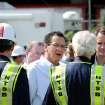 Gov. Dannel Malloy and Congressman Jim Himes, right, speak with NTSB representatives at a staging area near the scene of  the Metro-North train collision Saturday, May 18, 2013 in Bridgeport, Conn. Officials described a devastating scene of shattered cars and other damage where two trains packed with rush-hour commuters collided in Connecticut, saying Saturday it's fortunate that no one was killed and that there weren't even more injuries. (AP Photo/The Connecticut Post, Cathy Zuraw) MANDATORY CREDIT