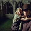 FILE - This publicity film image released by Universal Pictures shows Hugh Jackman as Jean Valjean holding Isabelle Allen as Young Cosette in a scene from