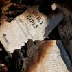 Burned pages of a Bible are seen in the charred ruins of Susan Harmon's family home Tuesday afternoon, July 19, 2011. Her pet dog, Pal,  awakened Susan  with constant barking Sunday night when the home caught fire.  Susan's son, Walt, 24,  credits the pet with saving his life and allowing him to rescue his mother, and her parents, Harold and Donna Gilliam.  from the smoke-filled home before it was destroyed by flames.   The home is in rural Lincoln County about six miles north of Jacktown.     Photo by Jim Beckel, The Oklahoman