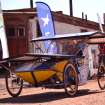 In this photo released by Carrera Solar Atacama 2012, a driver sits in his solar powered car from the team BozzEnergy at the start of the first phase of a race, in Humberstone in the area of Pozo Almonte, Chile, Thursday, Nov. 15, 2012. Most participants belong to universities and one entry rule stipulates that cars cannot cost more then $7,000 dollars. (AP Photo/Carrera Solar Atacama 2012)