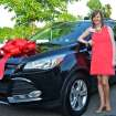 Oklahoma City Public School's new Teacher of the Year, Meredith Ziegler, with the new car she received as part of her award at the Oklahoma City public schools Teacher of the Year ceremony Thursday, May 8, 2014 at the Will Rogers Theater. Photo by M. Tim Blake, for The Oklahoman