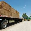 Danny Freerer,  of Fargo, unloads a shipment of hay he had trucked in to feed his cattle during the current drought. Feerer said the only other option is to sell his animals early.     Lack of rain and a string of days when temperatures exceeded  100 degrees have created extreme conditions for farmers, ranchers and citizens of many communities in western Oklahoma.   by Jim Beckel, The Oklahoman.