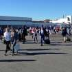 In this photo provided by John Forstrom, which has been authenticated based on its contents and other AP reporting, people walk across the tarmac after being evacuated from Los Angeles International Airport, Friday, Nov. 1, 2013.  Shots were fired Friday at Los Angeles International Airport, prompting authorities to evacuate a terminal and stop flights headed for the city from taking off from other airports.(AP Photo/John Forstrom)