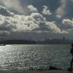 With San Francisco's skyline in the distance, a jogger in Berkeley, Calif., runs beneath storm clouds on Monday, Nov. 9, 2015. A storm crossed the region Monday morning, bringing rain, thunder and lightning to the drought-parched region. (AP Photo/Noah Berger)