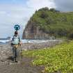 In this undated photo provided by Google, Rob Pacheco, president of Hawaii Forest & Trail, walks across the beach at Pololu Valley near Kapaau, Hawaii, while wearing the Street View Trekker. Hawaii's volcanoes, rainforests and beaches will soon be visible on Google Street View. The Mountain View, Calif., company said Thursday June 27, 2013 it was lending its backpack cameras to a Hawaii trail guide company to capture panoramic images of Big Island hiking trails. (AP Photo/Google)