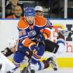 Colorado Avalanche's Ryan O'Byrne, left, falls behind Edmonton Oilers' Sam Gagner during the first period of an NHL hockey game in Edmonton, Alberta, on Friday, Dec. 9, 2011. (AP Photo/The Canadian Press, John Ulan)