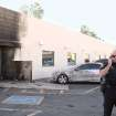 Police investigate an apparent bomb explosion at the Social Security Administration office on Marshall Street in downtown Casa Grande, Ariz. on Friday, Nov. 30, 2012. No one was hurt in the explosion and federal authorities are conducting the investigation. (AP Photo/Casa Grande Dispatch, Steven King)