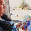Charlotte Pemberton- Rhopp, 32, holds a childhood portrait of her son, Derek.  She is wanting the  Kay County District Attorney's office to bring criminal charges against her stepfather, who Pemberton-Rhopp says sexually abused her when she was a young girl. Pemberton-Rhopp  insists the stepfather raped her 17 years ago and is the father of her son, Derek. Her stepfather denies the allegations.  Pemberton-Rhopp was successful in forcing him to take a paternity test last year and the DNA results suggest there is a very strong indication he is the father of her son. She was photographed at the front door of her home in Blackwell on Thursday, Jan. 26, 2012.   Photo by Jim Beckel, The Oklahoman