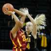 Iowa State forward Brynn Williamson (22) looks to pass around Iowa guard Jaime Printy (24) during the first half an NCAA college basketball game Thursday, Dec. 6, 2012 at Carver-Hawkeye Arena in Iowa City, Iowa.  (AP Photo/The Gazette,Brian Ray)