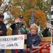 Members of the Veterans of Foreign Wars from Goldsby, Oklahoma wave to the crowd during the Veterans Day parade in Norman Sunday. PHOTO BY HUGH SCOTT FOR THE OKLAHOMAN  ORG XMIT: KOD