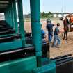 Gate crew work together to get a horse into a chute in the starting gate during a morning practice session at Remington Park Racetrack on Tuesday,  Aug. 16, 2011.  by Jim Beckel, The Oklahoman