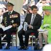 Britain's Prince Philip, French Prime Minister Manuel Valls and Britain's Queen Elizabeth II, from left, attend the Service of Remembrance, at the Commonwealth War Graves Commission Cemetery, in Bayeux, France Friday June 6, 2014, as part of the commemorations for the 70th anniversary of the D-Day landings. (AP Photo/Remy de la Mauviniere/Pool)