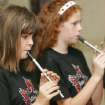 Lydia Hill, 12-year-old, and Maureen Sharp, 12-year-old, play their penny whistles during Celtic Camp at the First Unitarian Church in Oklahoma City , Okla. July 25 , 2008.  BY STEVE GOOCH, THE  OKLAHOMAN