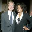 Michael Douglas greets Oprah Winfrey at the United Nations Association of the United States Global Leadership Awards Dinner, Thursday, Sept. 30, 2004, in New York. Oprah Winfrey was presented with the 2004 Global Humanitarian Action Award for her philanthropic efforts. (AP Photo/Diane Bondareff)