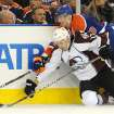 Edmonton Oilers' Eric Belanger, right, falls on the Colorado Avalanche's Chuck Kobasew during the first period of an NHL hockey game in Edmonton, Alberta, on Friday, Dec. 9, 2011. (AP Photo/The Canadian Press, John Ulan)