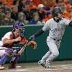 South Carolina's Max Schrock, right, hits a sacrifice fly as Clemson catcher Garrett Boulware looks on in an NCAA college baseball game on Friday, March 1, 2013, in Clemson, S.C. (AP Photo/Anderson Independent-Mail, Mark Crammer)  GREENVILLE NEWS OUT, SENECA NEWS OUT