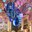 This January 2013 photo provided by The Venetian in Las Vegas shows a Chinese New Year art installation welcoming the year of the snake in the waterfall atrium connecting The Venetian and The Palazzo resorts. The display features an animatronic snake coiled in a tree decorated with flowers, lanterns and coins. Las Vegas celebrates Chinese New Year in a big way with feasts, exhibits, performances and other events around the city. The year of the snake begins Feb. 10. (AP Photo/The Venetian, Audrey Dempsey)
