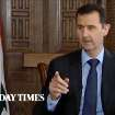 In this image taken from video filmed on Thursday, Feb. 28, 2013 and released Saturday evening, March 2, 2013, Syrian President Bashar Assad gestures while speaking during an interview with the Sunday Times, in Damascus, Syria. Iran and Syria condemned a U.S. plan to assist rebels fighting to topple Assad on Saturday and signaled the Syrian leader intends to stay in power at least until 2014 presidential elections. Assad told the Sunday Times in the interview timed to coincide with U.S. Secretary of State John Kerry's first foreign trip that