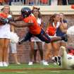 Virginia cornerback Chase Minnifield (13) dives over William & Mary wide receiver D.J. Mangas for an interception and touchdown that was called back due to pass interference during the first half of an NCAA college football game on Saturday, Sept. 3, 2011, in Charlottesville, Va. (AP Photo/Andrew Shurtleff)