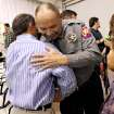 Grady County Sheriff's Deputy Roy Spratt (right) hugs Pastor David Rivers following the Surthrivor Service (CQ) SURTHRIVOR at Ridgecrest Baptist Church in Bridge Creek Oklahoma on May 3, 2009. Photo by John Clanton ORG XMIT: KOD