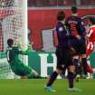 Olympiakos' Giannis Maniatis, right, scores against Arsenal during a group B Champions League soccer match in the port of Piraeus, near Athens, Tuesday, Dec. 4, 2012. (AP Photo/Thanassis Stavrakis)