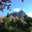 Foliage frames the Bugarach mountain peak in southern France, Monday, Dec. 10, 2012.  From Russia to California, thousands are preparing for the fateful day, when many believe a 5,125-year cycle known as the Long Count in the Mayan calendar supposedly comes to an end.  The Internet has helped feed the frenzy, spreading rumors that a mountain in the French Pyrenees is hiding an alien spaceship that will be the sole escape from the destruction.  French authorities are blocking access to Bugarach peak from Dec. 19-23 except for the village's 200 residents