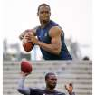 FILE- This combo image of March 2013 file photos shows quarterbacks, from top, Geno Smith,  E.J. Manuel and Matt Barkley during their respective NFL football pro days. Will any quarterbacks be taken in the first round? Possibilities include Geno Smith, Matt Barkley and E.J. Manuel_one of the things to watch for during the three-day NFL draft beginning Thursday, April 25, 2013. (AP Photos/File)