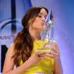 Kacey Musgraves kisses her award for new artist of the year backstage at the 47th annual CMA Awards at Bridgestone Arena on Wednesday, Nov. 6, 2013, in Nashville, Tenn. (Photo by Evan Agostini/Invision/AP)